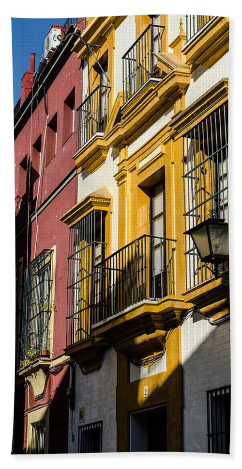 Spain Photographs Framed Prints Hand Towel featuring the photograph Streets Of Sevilla by Andrea Mazzocchetti