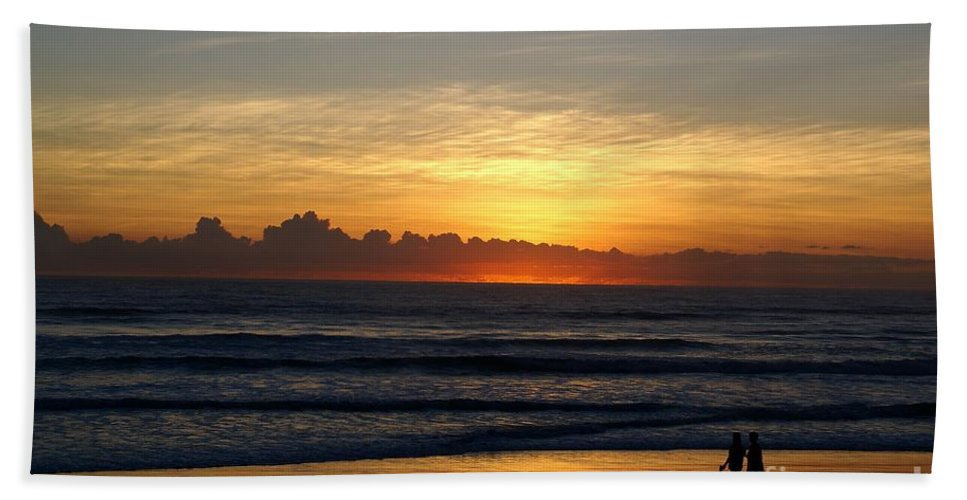 Beach Hand Towel featuring the photograph Strolling The Beach During Sunset by Patricia Twardzik