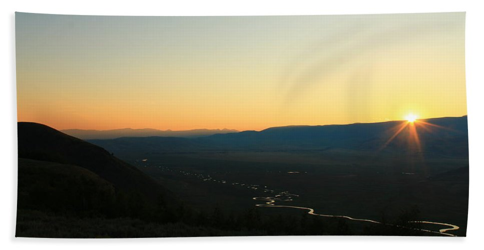 Jackson Hole Hand Towel featuring the photograph Sun Peeking Over The Mountains by Catie Canetti