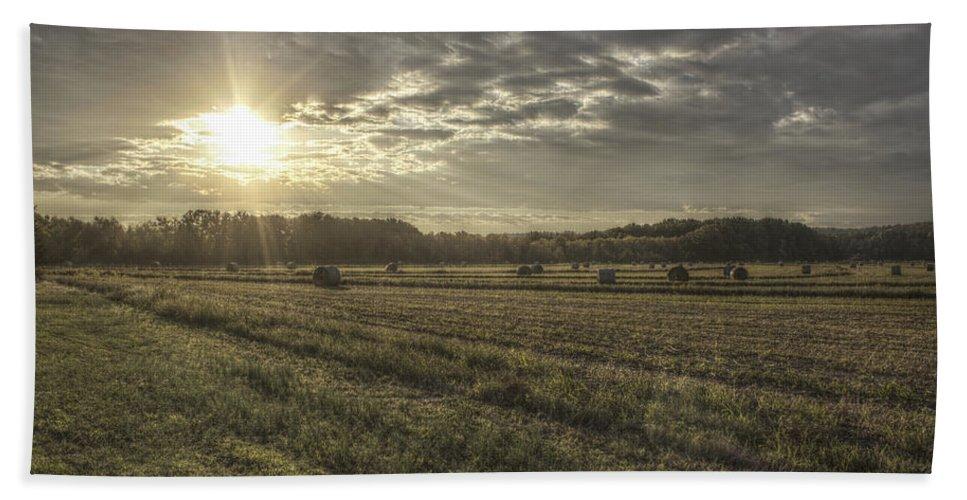 Hayrolls Hand Towel featuring the photograph Sunrise Over Hayrolls by Jason Politte