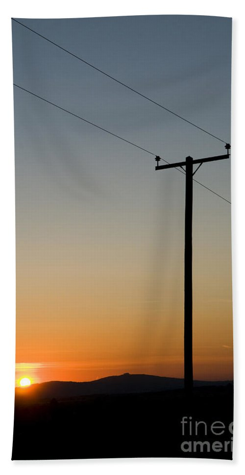 Blue Hand Towel featuring the photograph Sunset Cables by Anne Gilbert