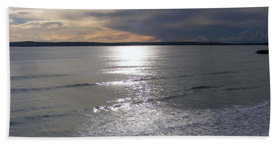 Beach Hand Towel featuring the photograph Sunset Over Calypso Beach by Jennifer Van Niekerk