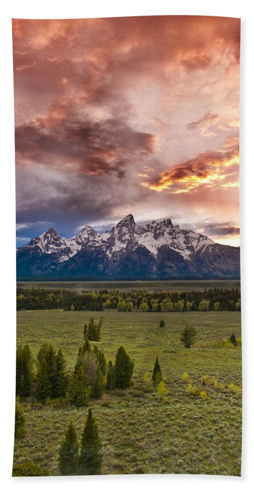 Grand Teton National Park Bath Towel featuring the photograph Sunset Over The Tetons by Greg Wyatt