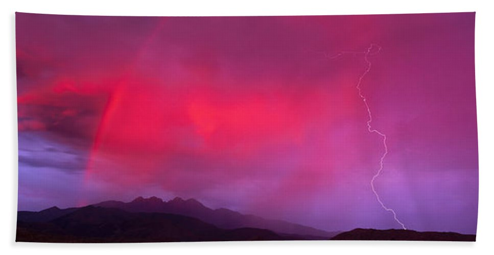 Photography Hand Towel featuring the photograph Sunset With Lightning And Rainbow Four by Panoramic Images