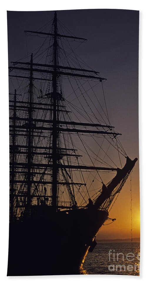 Travel Hand Towel featuring the photograph Tall Ship Silhouetted by Jim Corwin