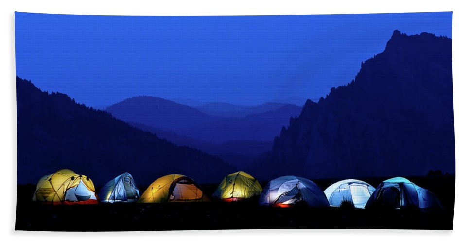 Adventure Hand Towel featuring the photograph Tents Illuminated Near Mountains by Celin Serbo