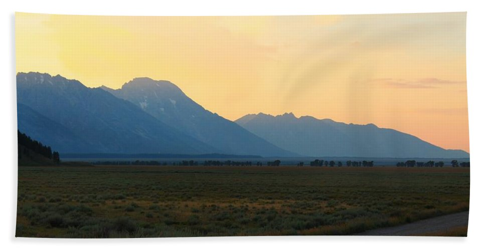 Sunset Bath Sheet featuring the photograph Tetons And Fields by Catie Canetti