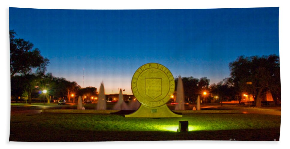 Texas Tech Seal At Night Bath Towel featuring the photograph Texas Tech Seal At Night by Mae Wertz