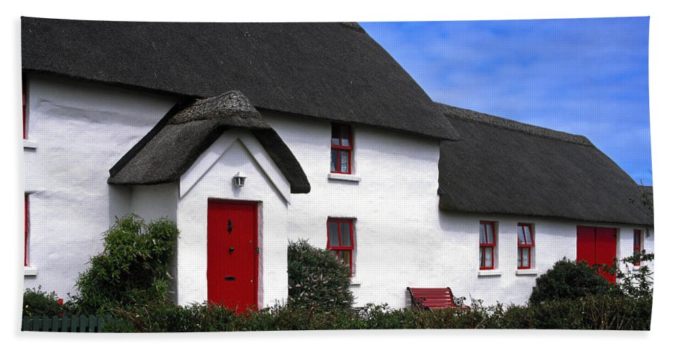 White Stucco House Hand Towel featuring the photograph Thatched Roof House by Sally Weigand