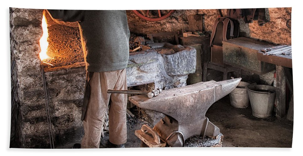 Blacksmith Hand Towel featuring the photograph The Blacksmith by Nigel R Bell