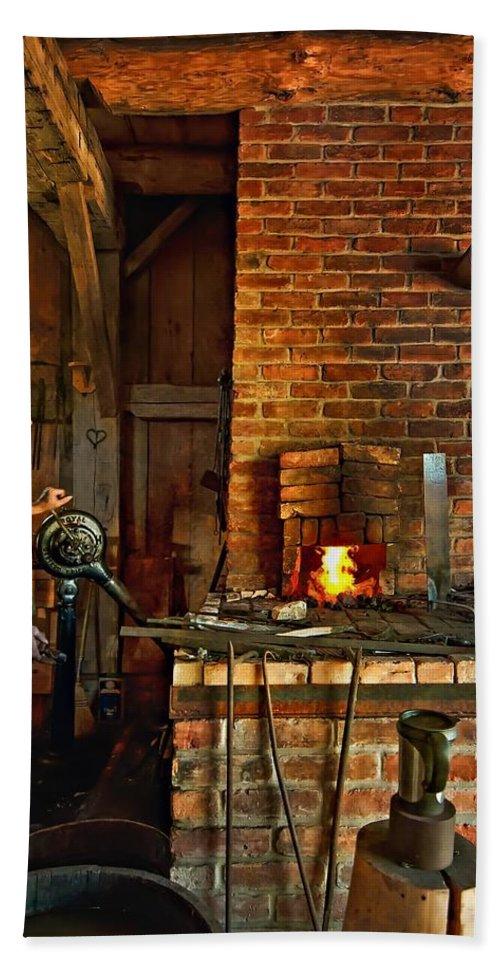 Blacksmith Bath Sheet featuring the photograph The Blacksmith by Steve Harrington