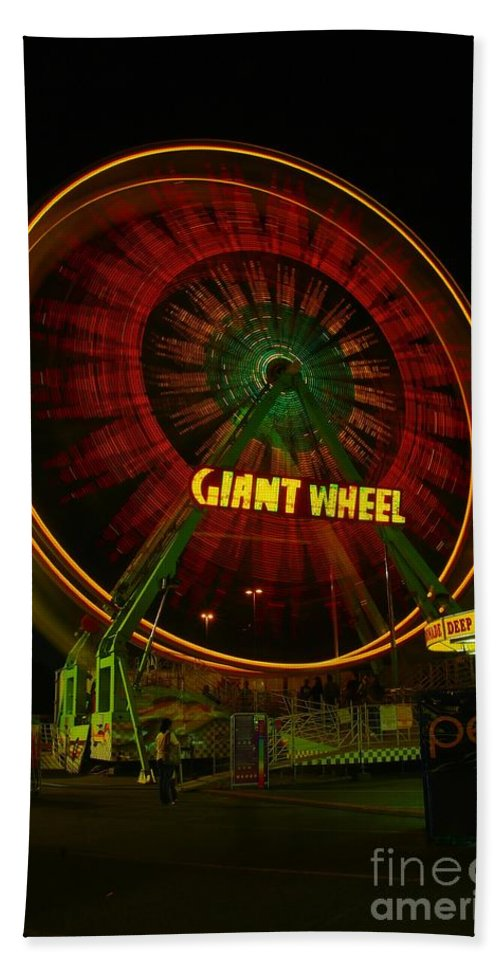 Movement Bath Sheet featuring the photograph The Giant Wheel Spinning by Jeff Swan