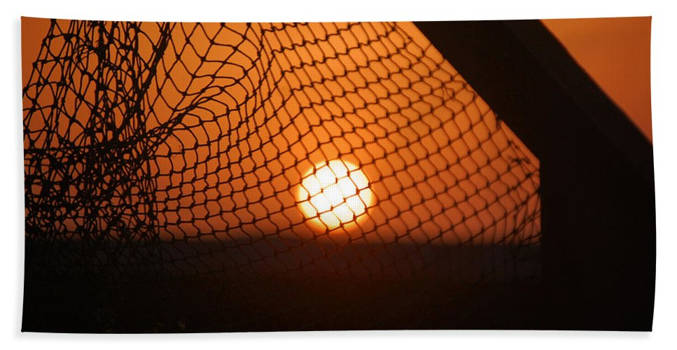 Net Bath Sheet featuring the photograph The Netted Sun by Leticia Latocki