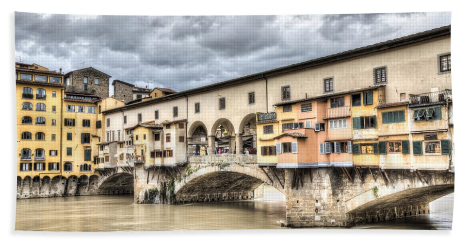 Ponte Vecchio Hand Towel featuring the photograph The Ponte Vecchio In Florence by Marc Garrido