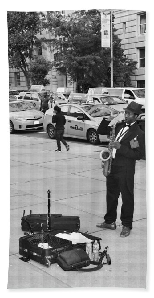 Scenic Hand Towel featuring the photograph The Saxman In Black And White by Rob Hans