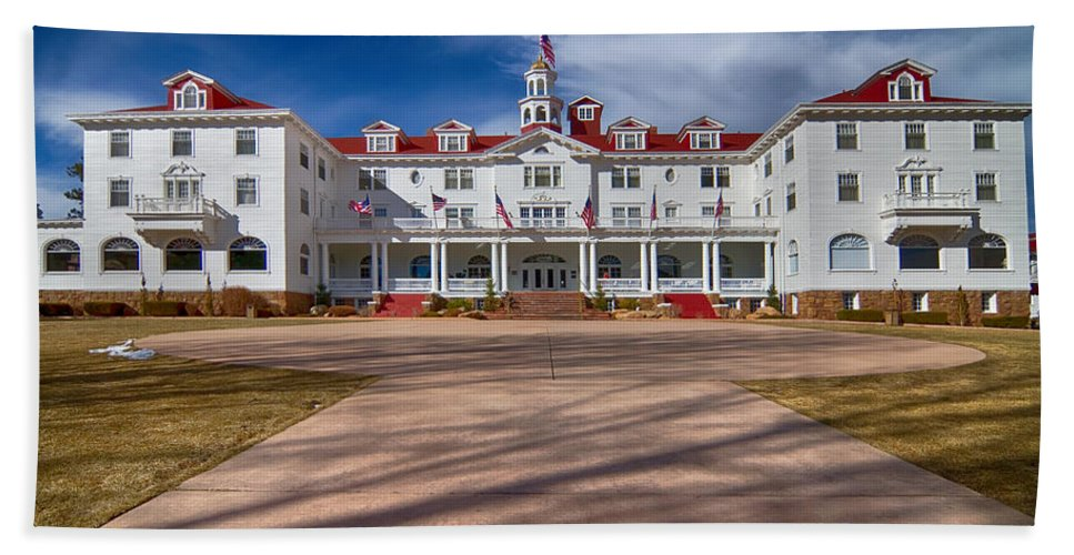 Stanley Hotel Hand Towel featuring the photograph The Stanley Hotel by James BO Insogna