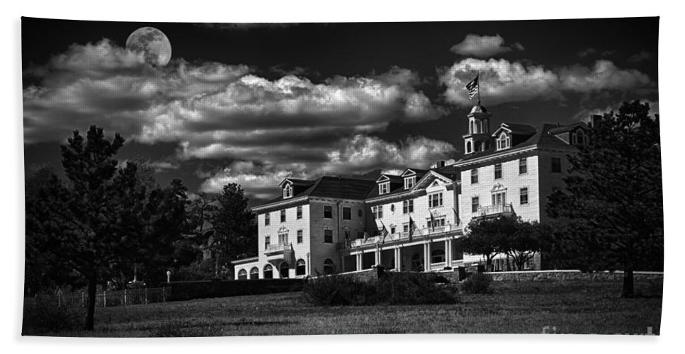 The Stanley Hotel Hand Towel featuring the photograph The Stanley Hotel by Priscilla Burgers