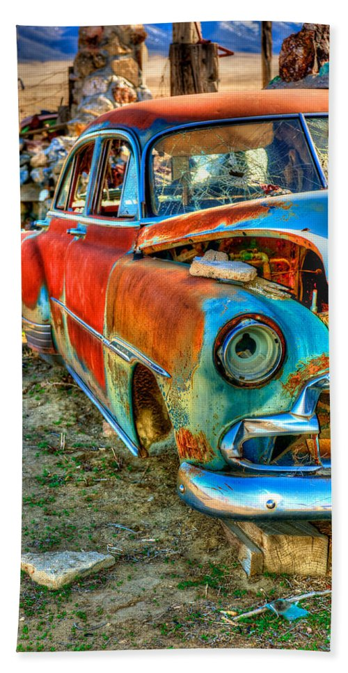 Thunder Mountain Indian Monument Bath Sheet featuring the photograph The Tired Chevy 2 by Richard J Cassato