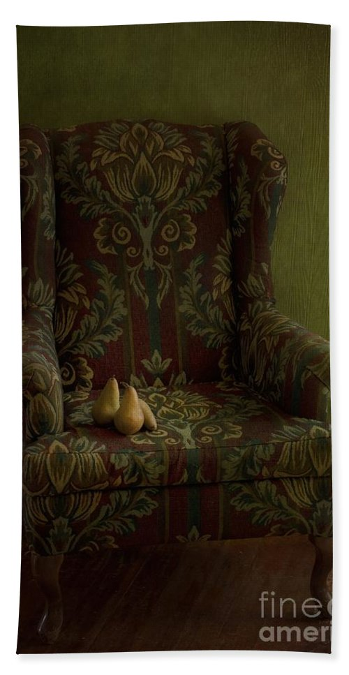 Chair Hand Towel featuring the photograph Three Pears Sitting In A Wing Chair by Priska Wettstein