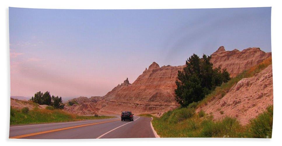 Through The Badlands Of South Dakota Hand Towel featuring the photograph Through The Badlands Of South Dakota by John Malone