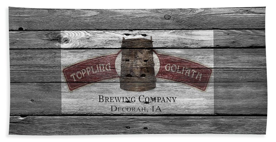 Toppling Goliath Hand Towel featuring the photograph Toppling Goliath by Joe Hamilton