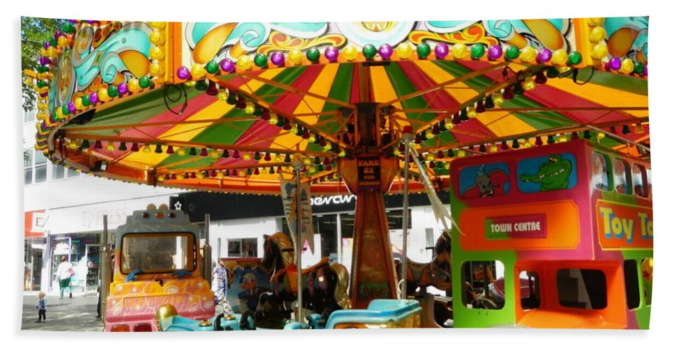 Cityscape Hand Towel featuring the photograph Toy Town Carousel by Loreta Mickiene
