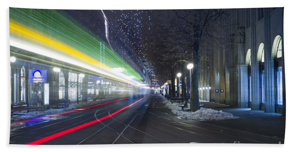 Tram Hand Towel featuring the photograph Tram At Night In Zurich Bahnhofstrasse by Mats Silvan