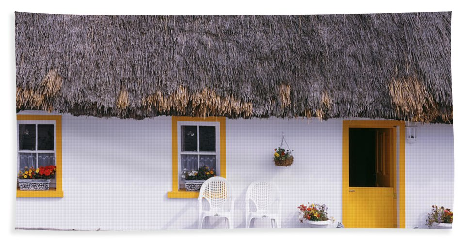 Photography Hand Towel featuring the photograph Two Chairs Outside A Cottage, County by Panoramic Images