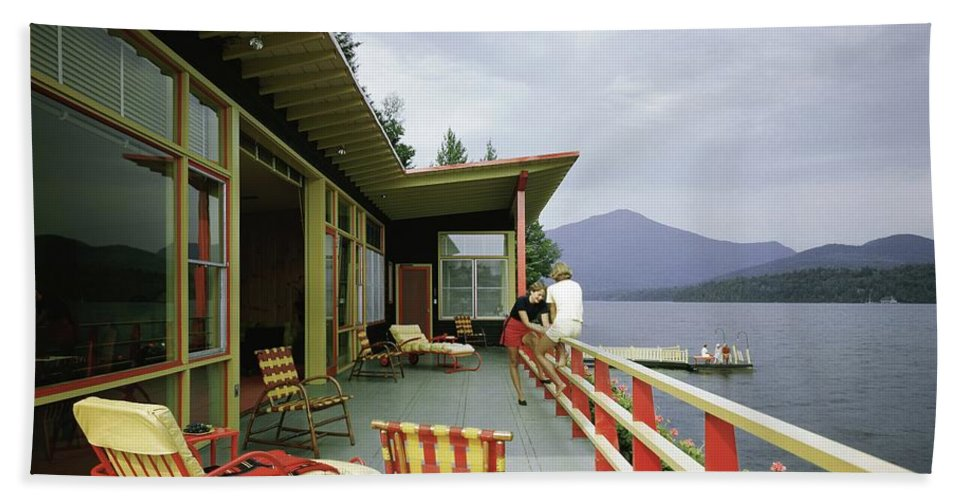 Alfred Rose Bath Towel featuring the photograph Two Women On The Deck Of A House On A Lake by Robert M. Damora