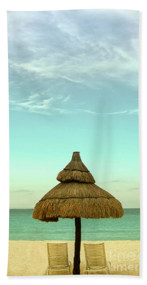 Beach; Serene; Secluded; Relax; Relaxation; Sunny; Tropic; Tropical; Vacation; Resort; No One; Empty; Clouds; Sky; Water; Sand; Ocean; Lake; Sea; Hut; Straw; Cover; Chairs; Lounge; Lovely; Beautiful Hand Towel featuring the photograph Under The Umbrella by Margie Hurwich