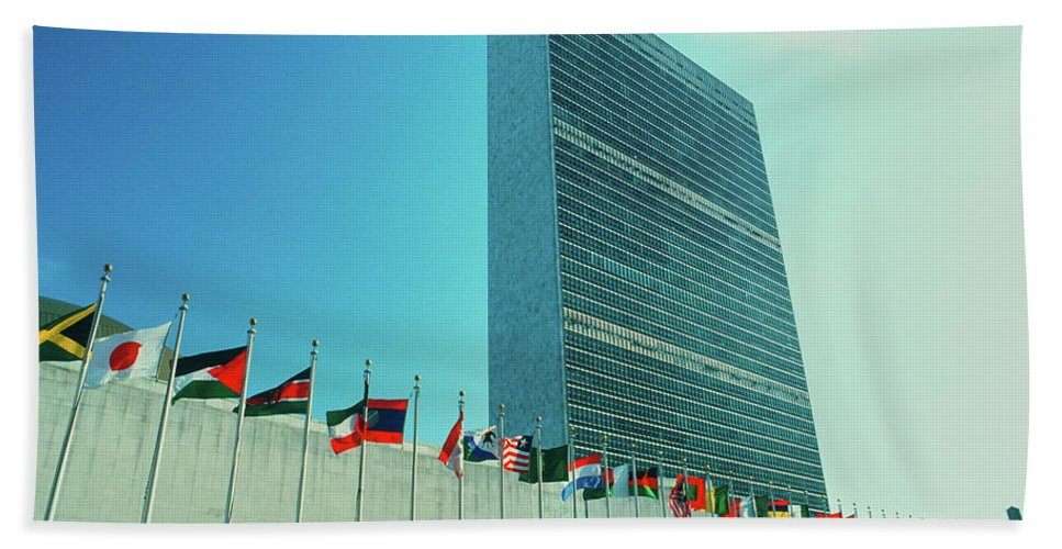 Photography Bath Sheet featuring the photograph United Nations Building With Flags by Panoramic Images