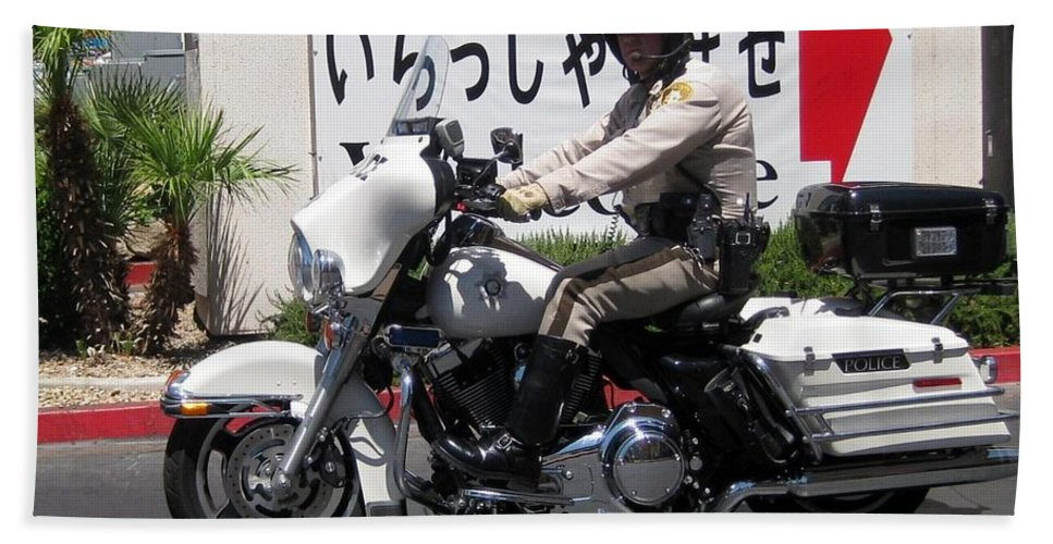 Vegas Motorcycle Cop Hand Towel featuring the photograph Vegas Motorcycle Cop by John Malone