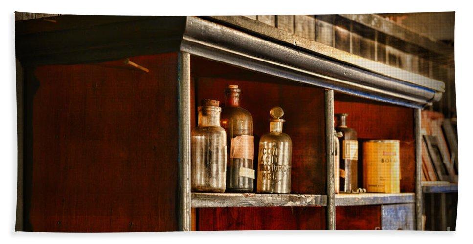 Paul Ward Bath Sheet featuring the photograph Vintage Druggist Shelf by Paul Ward