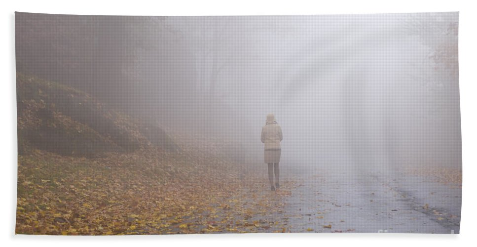 Woman Hand Towel featuring the photograph Walking On A Foggy Road by Mats Silvan