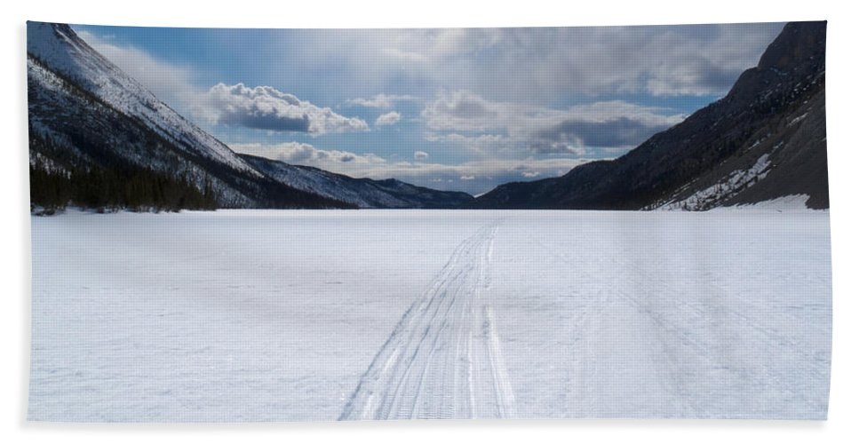 Blue Hand Towel featuring the photograph Well Used Winter Trail On Frozen Mountain Lake by Stephan Pietzko