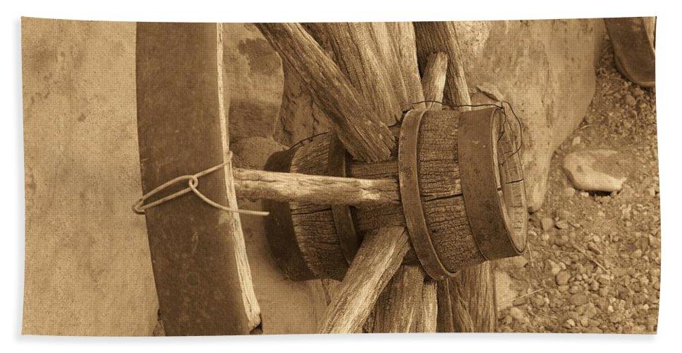 Wagon Wheel Bath Sheet featuring the photograph Wheel Of Time II by Brandi Maher
