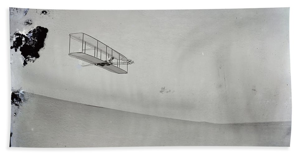 The Wright Brothers Hand Towel featuring the photograph The Wright Brothers Wilbur Gliding Down Steep Slope Of Big Kill Devil Hill by R Muirhead Art