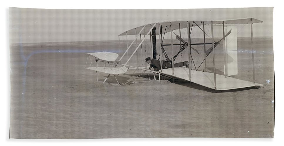 The Wright Brothers Bath Sheet featuring the photograph The Wright Brothers Wilbur In Prone Position In Damaged Machine by R Muirhead Art