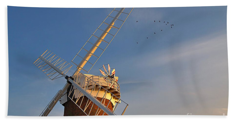 Windmill Hand Towel featuring the photograph Windmill At Dusk On The Norfolk Broads In Autumn by Louise Heusinkveld