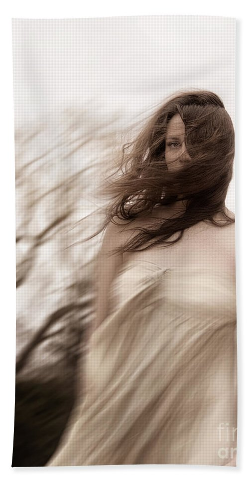 Caucasian; Woman; Lady; Female; Outside; Outdoors; Storm; Stormy; Wind; Windy; Blur; Blurred; Blurry; Horror; Scary; Mysterious; Mystery; Foreboding; Hair; Long Hair; Brunette; Dress; Gold; Strapless; Haunted; Scared; Terror; Trees; Autumn; Spring; Branches Hand Towel featuring the photograph Windy by Margie Hurwich