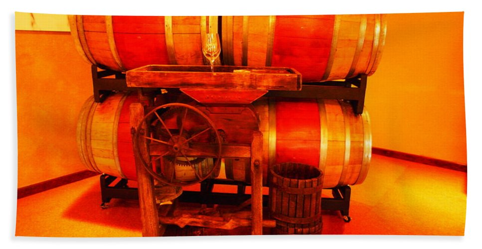 Wine Bath Towel featuring the photograph Wine Casks And A Grape Crusher by Jeff Swan