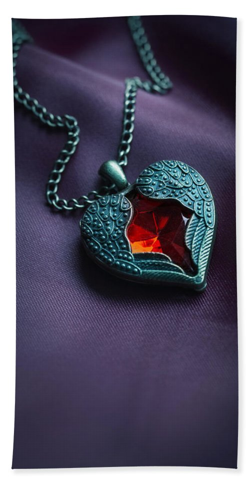 Jewellery Hand Towel featuring the photograph Winged Heart With Red Gem by Jaroslaw Blaminsky