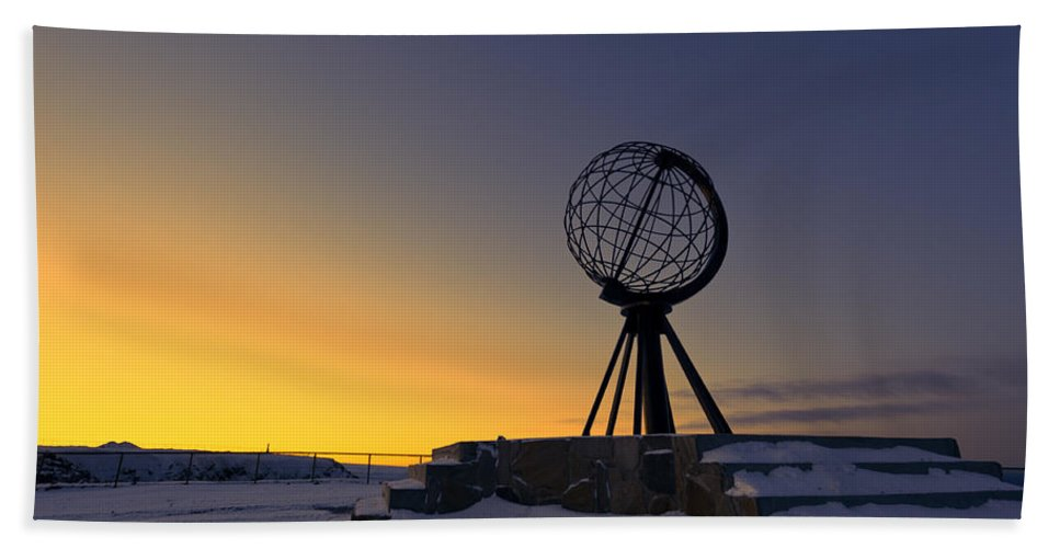 Longitude; Latitude; Arctic; Cape; Concept; Europe; European; Evening; Famous; Globe; Monument; Nature; Nordkapp; North; Northern; Northland; Norway; Norwegian; Point; Postcard; Scandinavia; Sign; Silhouette; Sky; Sphere; Statue; Sun; Sunset; Symbol; Symbolic; Tourism; Travel; View; World; Northernmost Point; Dawn; Dusk; Golden Hand Towel featuring the photograph Winter Beyond The Arctic Circle by U Schade