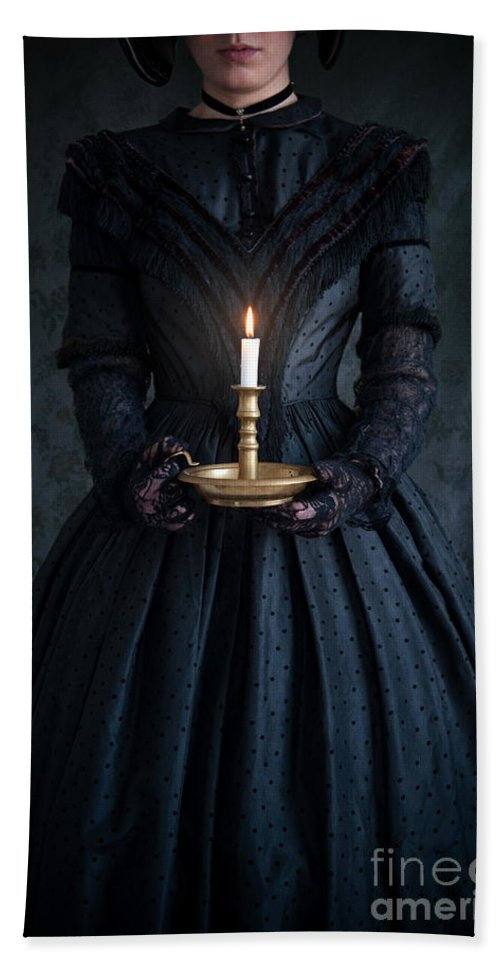 Victorian Hand Towel featuring the photograph Woman In A Victorian Mourning Dress Holding A Candle by Lee Avison