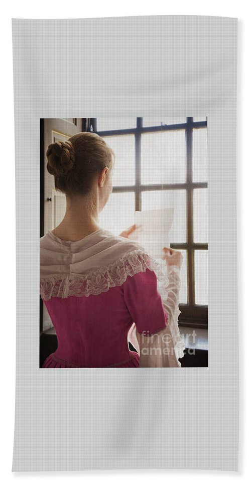 Woman Bath Sheet featuring the photograph Woman In Historical Costume Reading A Letter By The Window by Lee Avison