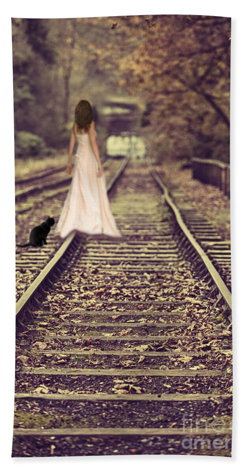Woman Hand Towel featuring the photograph Woman On Railway Line by Amanda Elwell