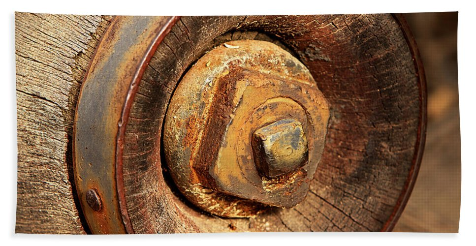 Wheel Hand Towel featuring the photograph Wooden Wheel Hub by Phyllis Denton