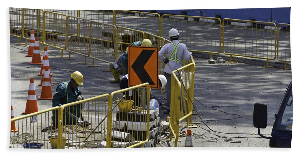 Action Bath Sheet featuring the photograph Workers Preparing The Road Surface And Sides Preparing For The Formula 1 by Ashish Agarwal