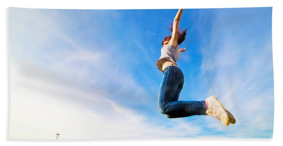 Grass Bath Sheet featuring the photograph Young Beautiful Woman Jumping For Joy by Michal Bednarek