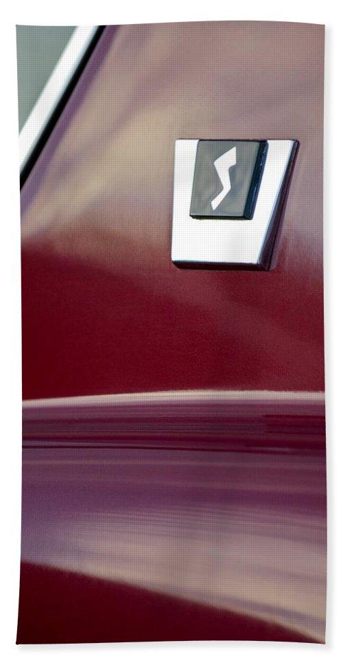 1964 Studebaker Avanti Hand Towel featuring the photograph 1964 Studebaker Avanti Emblem by Jill Reger